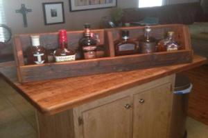 Mooneyham Brothers Furniture Invents a beautiful Rustic Whiskey Rack